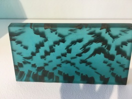 seaweed set in resin. looks like its still drifting in the sea.